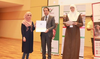 Honoring students participating in scientific activities at AAU in Abu Dhabi